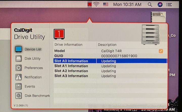 "CalDigit Drive Utility window showing list of drives description as ""updating""."