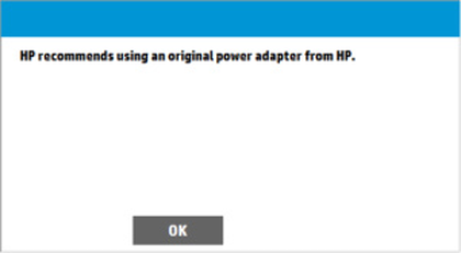 """HP recommends using an original power adapter from HP"" message depicted."